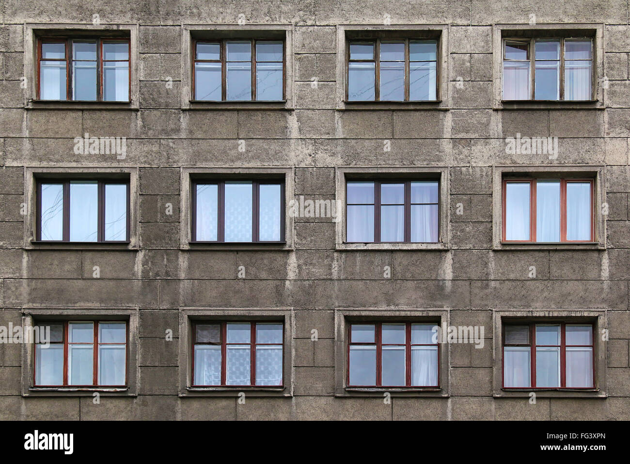 Many windows in row on facade of urban apartment building for Exterior view of building