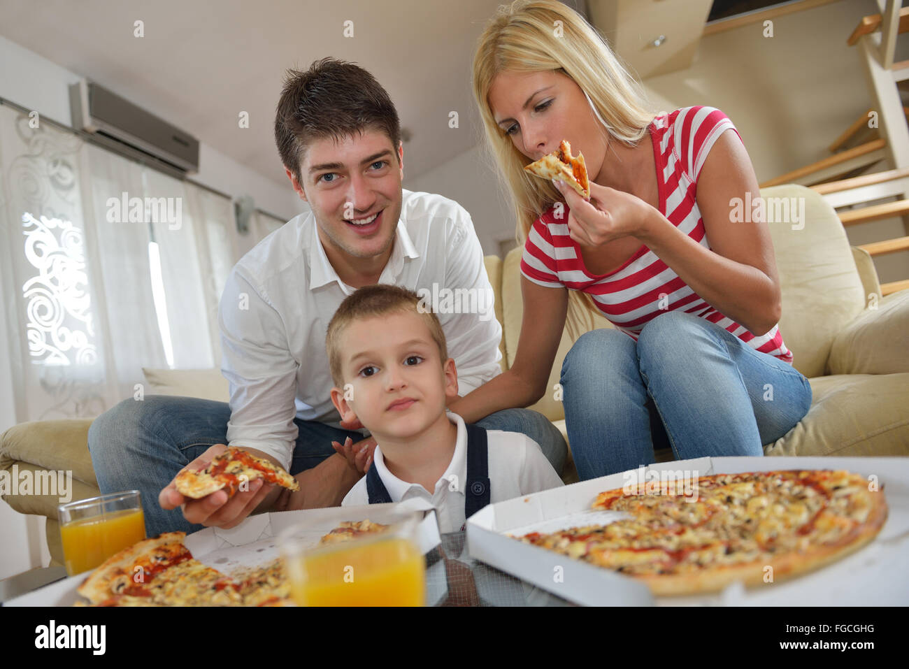 family eating pizza Stock Photo, Royalty Free Image ...