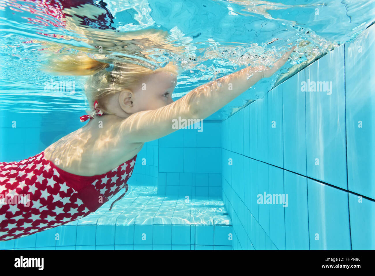 Child Swimming Lesson Girl Learning To Dive Underwater In Pool Stock Photo Royalty Free Image