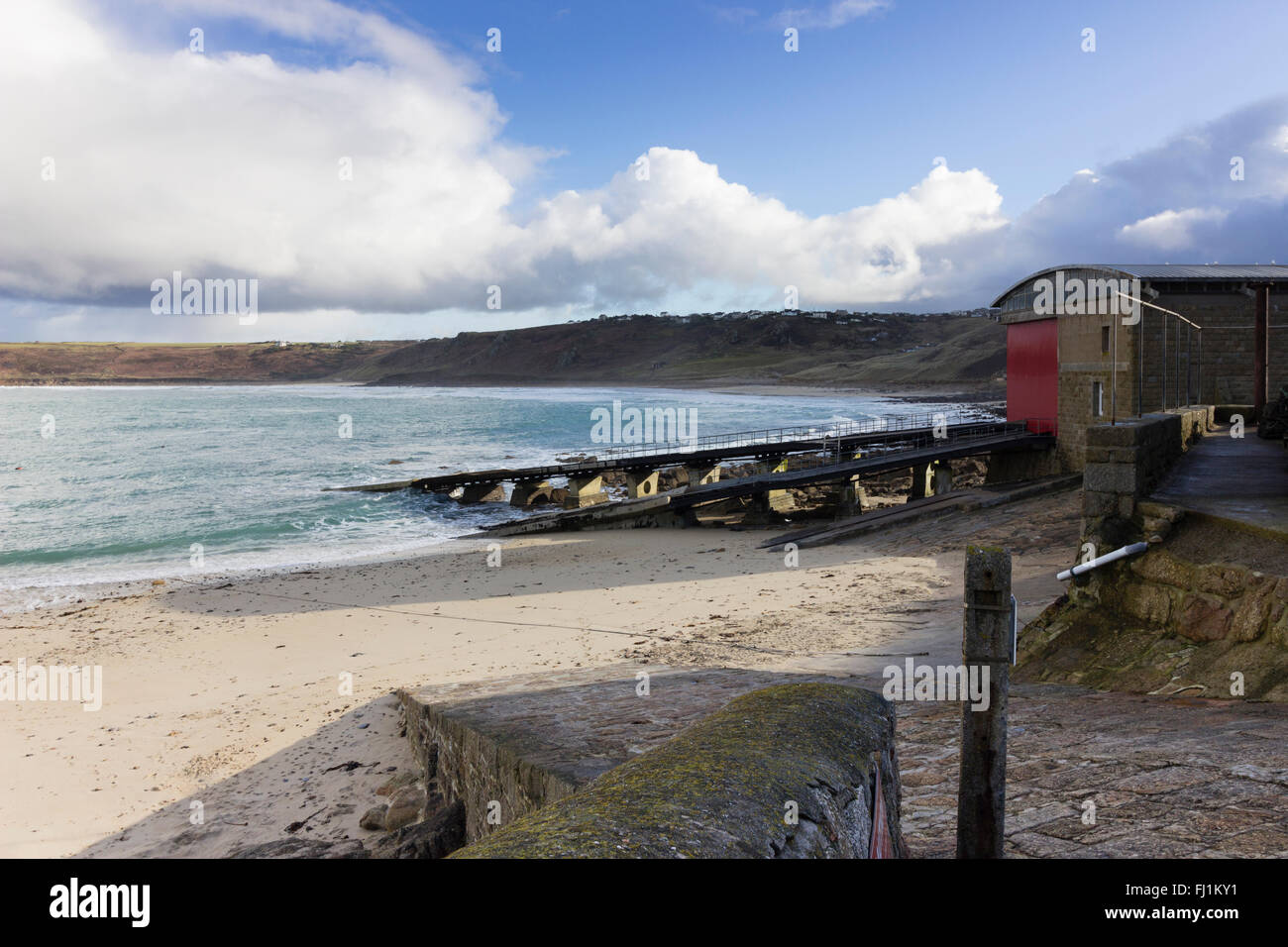 sennen-cove-lifeboat-station-with-launch-ramps-against-a-deserted-FJ1KY1.jpg