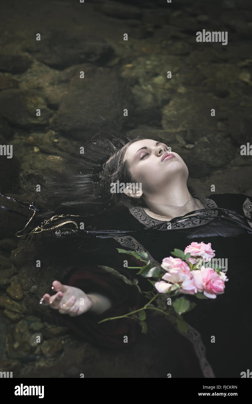 Beautiful drown woman in a river . Ophelia concept Stock Foto