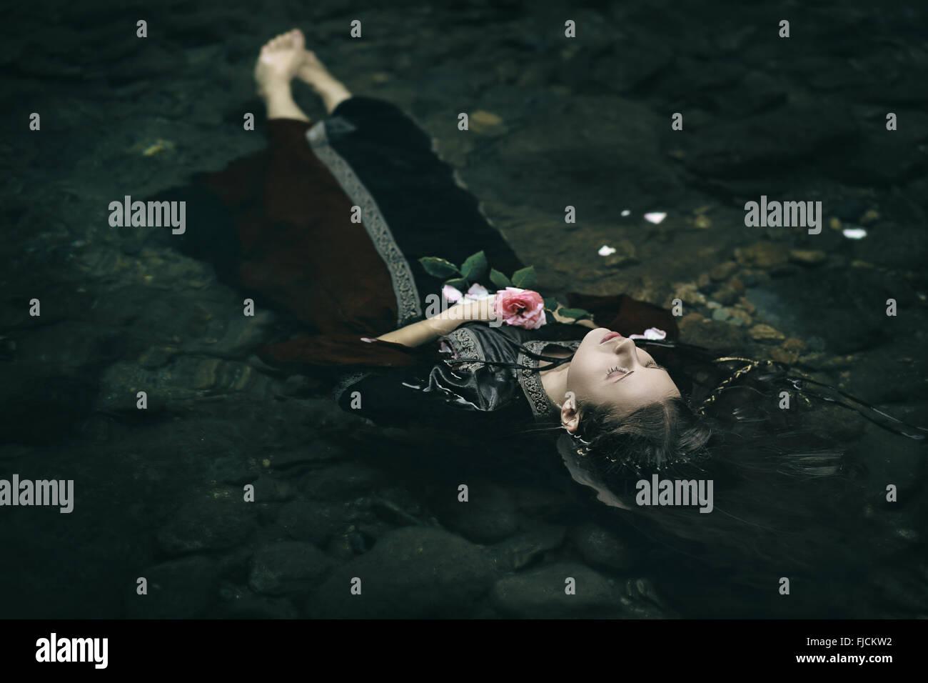 Beautiful floating dead woman in water . Ophelia ...