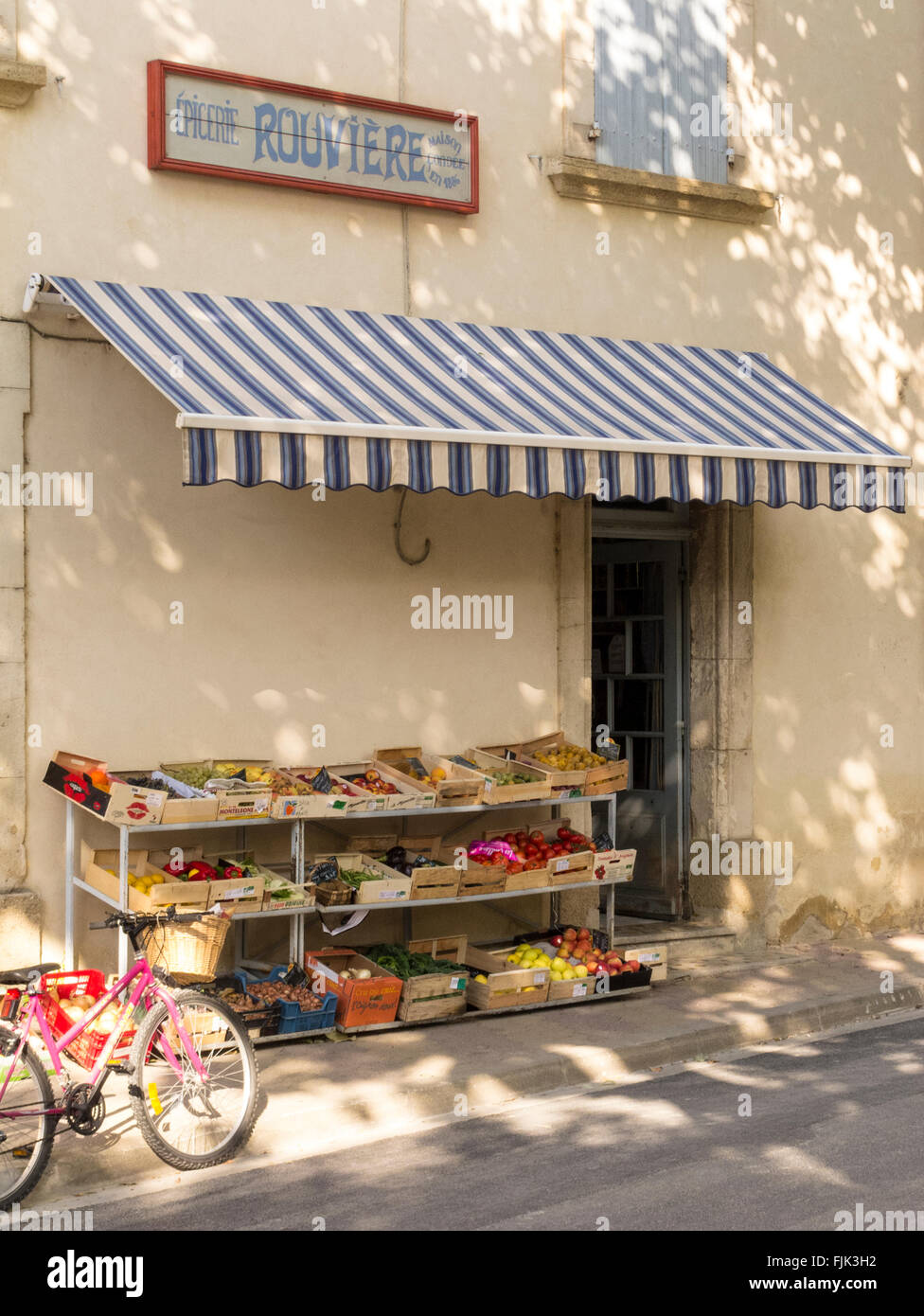 Exterior of typical small grocery store with traditional striped stock photo royalty free image - Boutique free perpignan ...