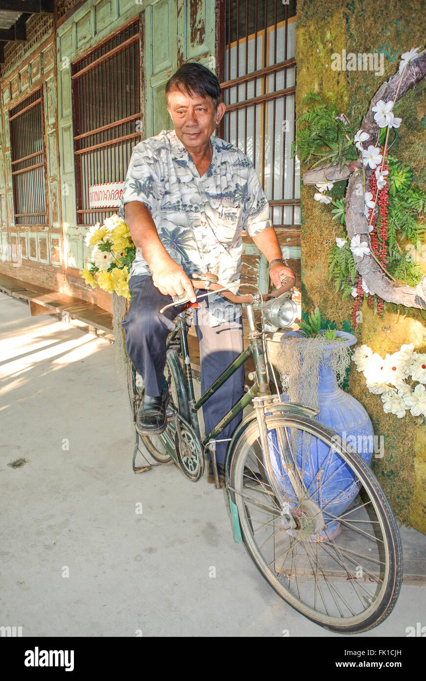 thai-man-on-a-bicycle-in-thailand-FK1CJH