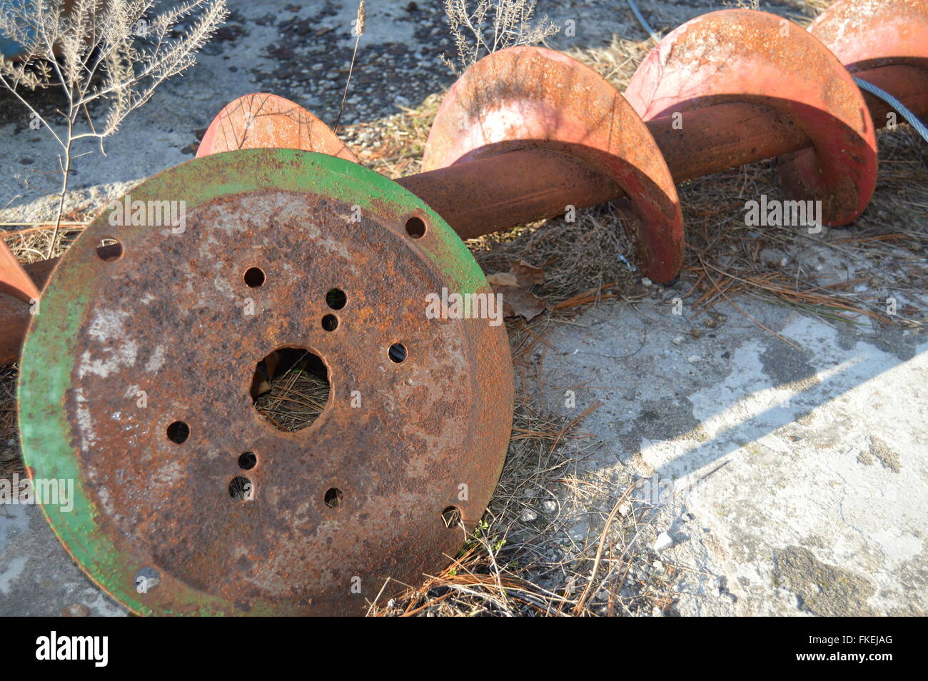 a-picture-of-a-rustic-auger-and-a-old-di
