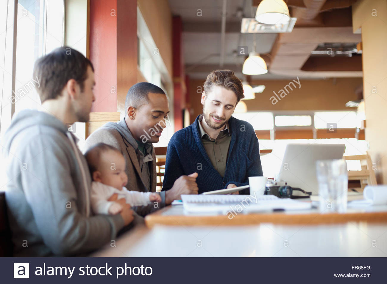 male friends in discussion at lunch Stock Photo