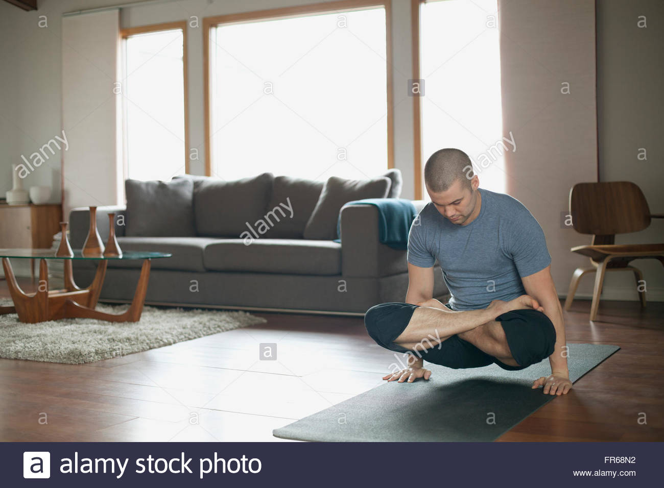 man doing yoga poses at home Stock Foto