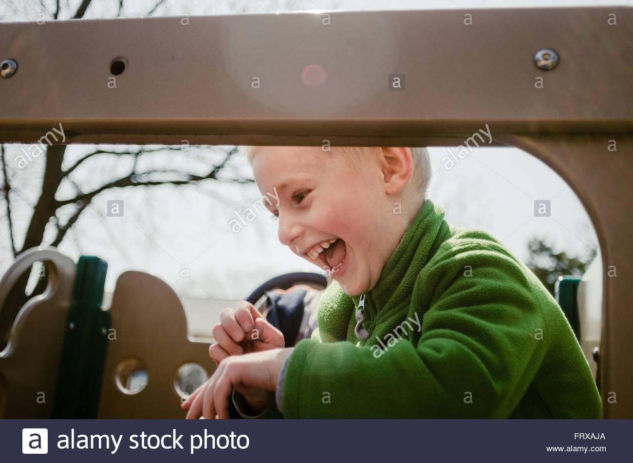 Happy kid at the playground Stock Photo