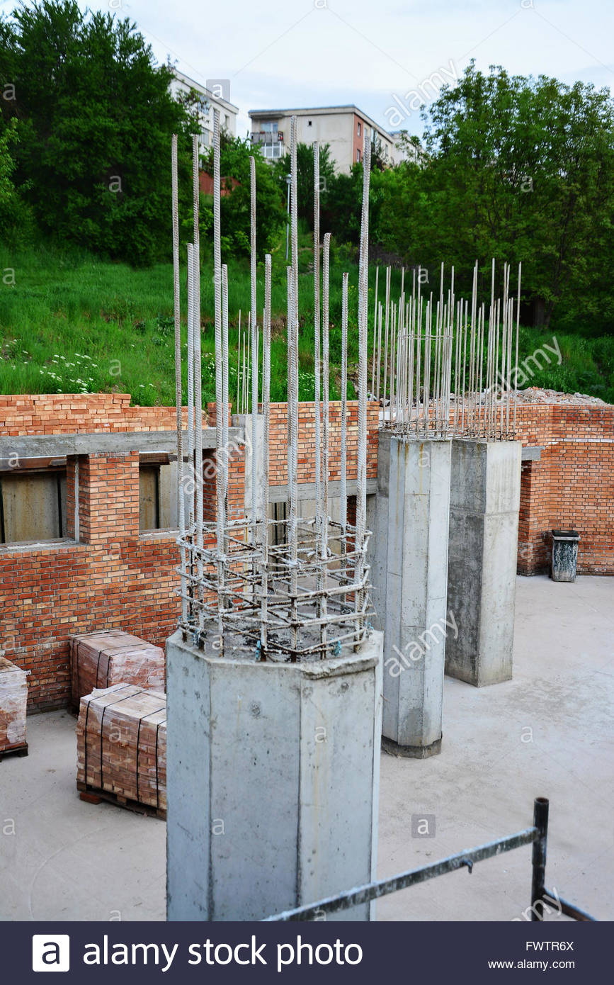 Reinforced concrete pillars and red brick masonry on house for Brick home construction costs