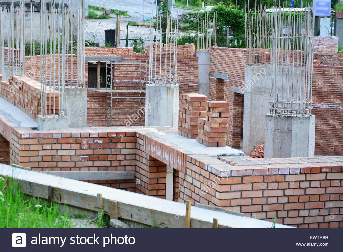 Red Brick Masonry And Reinforced Concrete Pillars On House