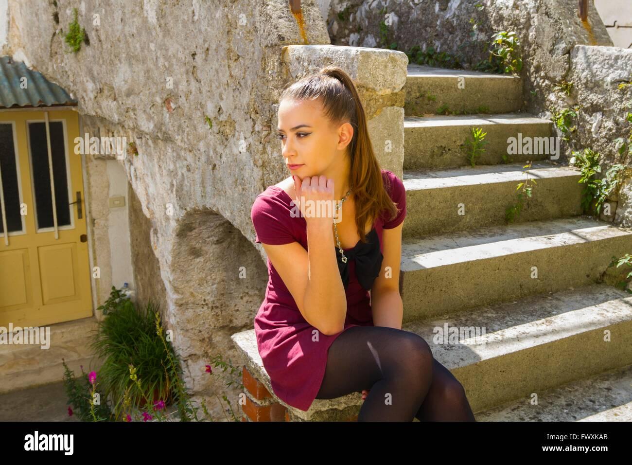 waiting before entrance teen girl violet short mini dress