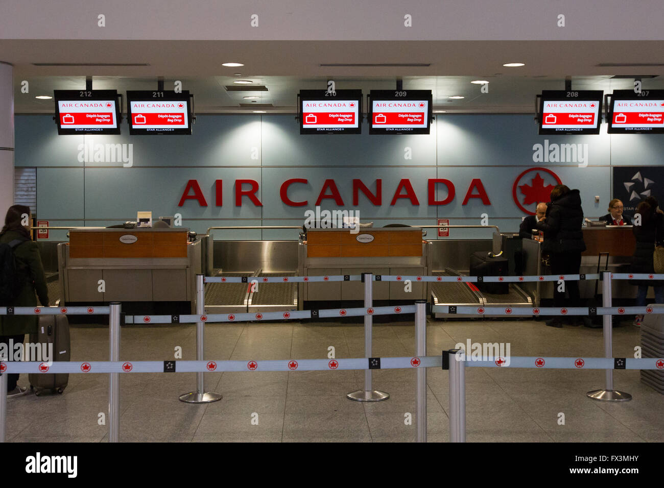 air canada check in counter at pierre elliot trudeau airport in stock photo royalty free image. Black Bedroom Furniture Sets. Home Design Ideas