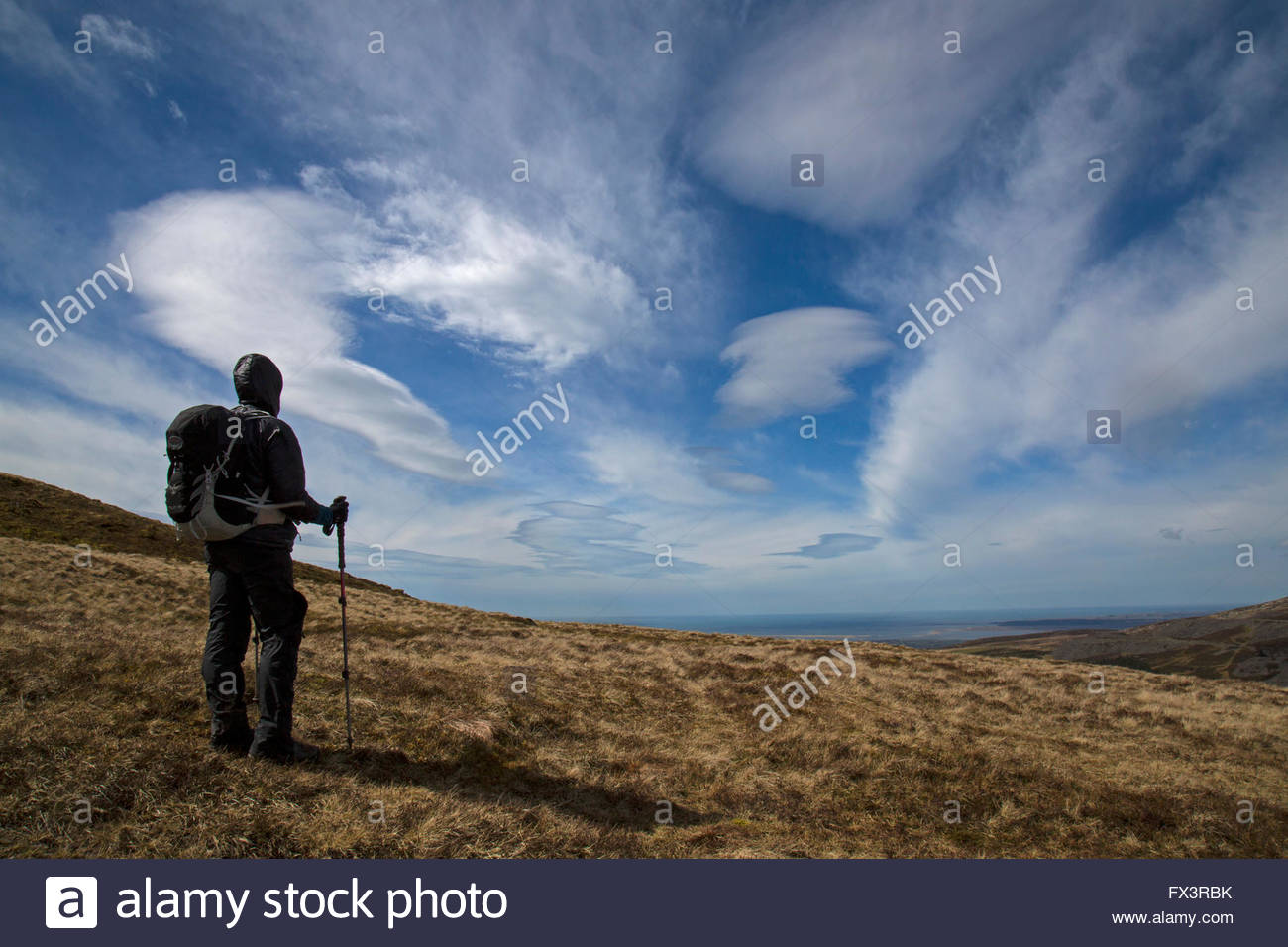 lone-female-hiker-staring-in-to-a-big-wi