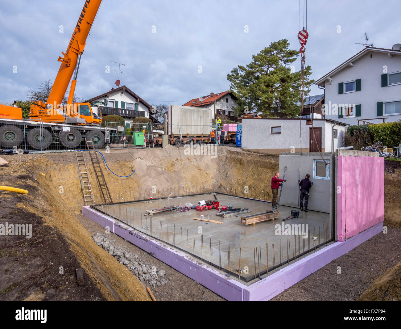 Prefabricated House Workers In Setting Up The Basement