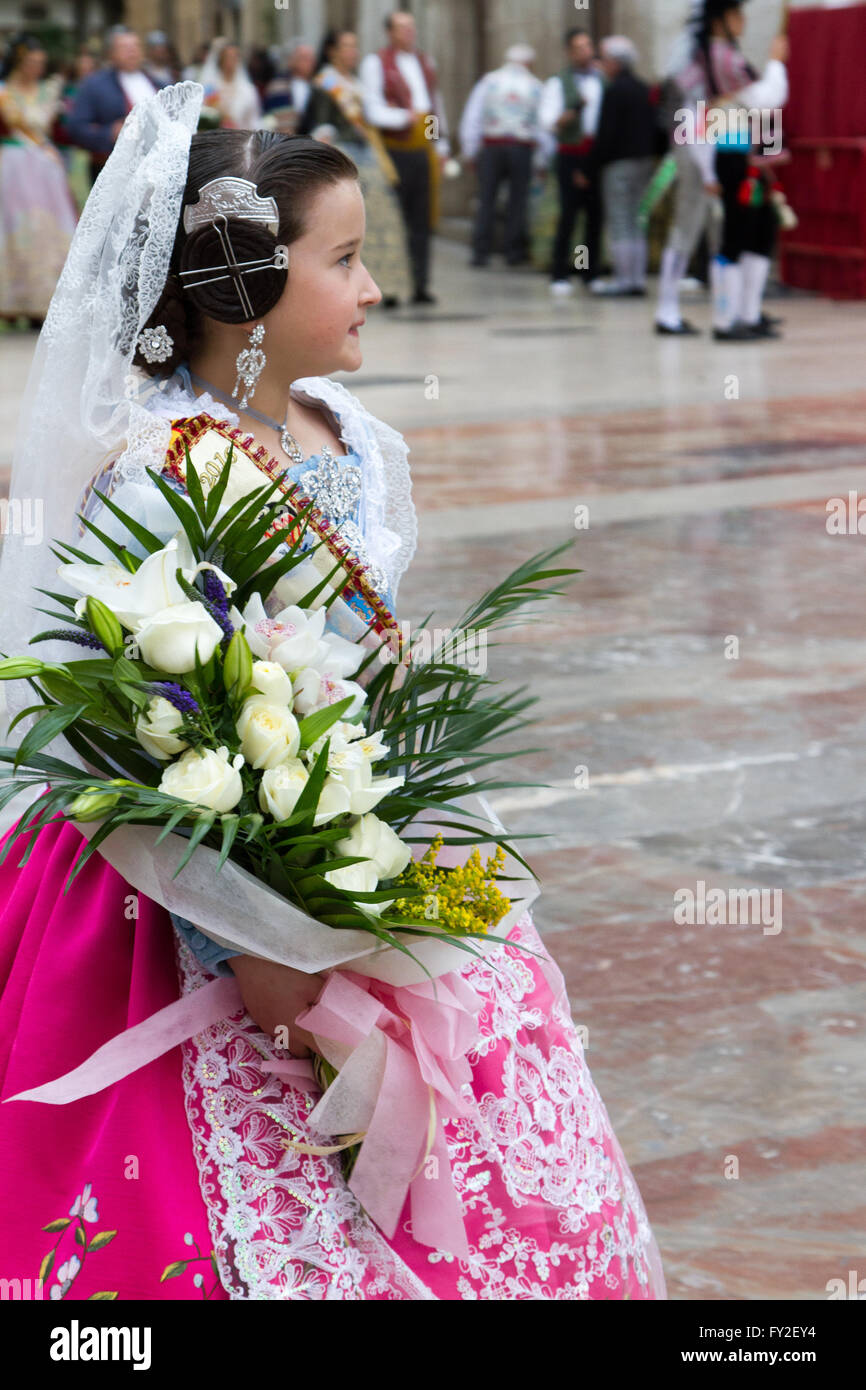 Girl bringing flower offering at the offering to the Holy Lady of Valencia Spain Stock Photo