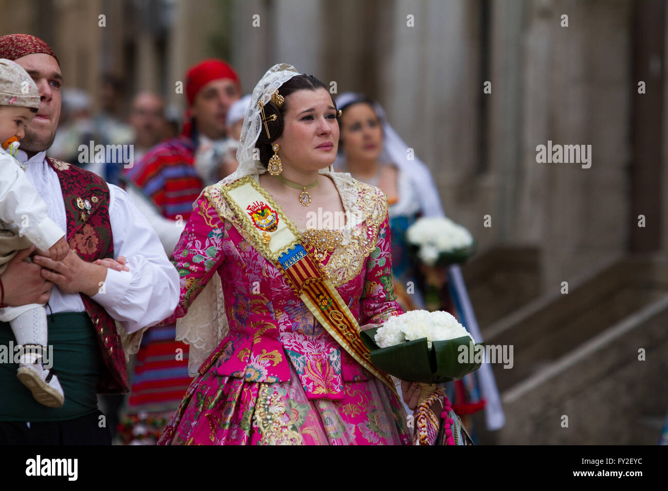 Flowering offering procession for the lady of the Forsaken during Fallas Festival  Valencia Spain Stock Photo