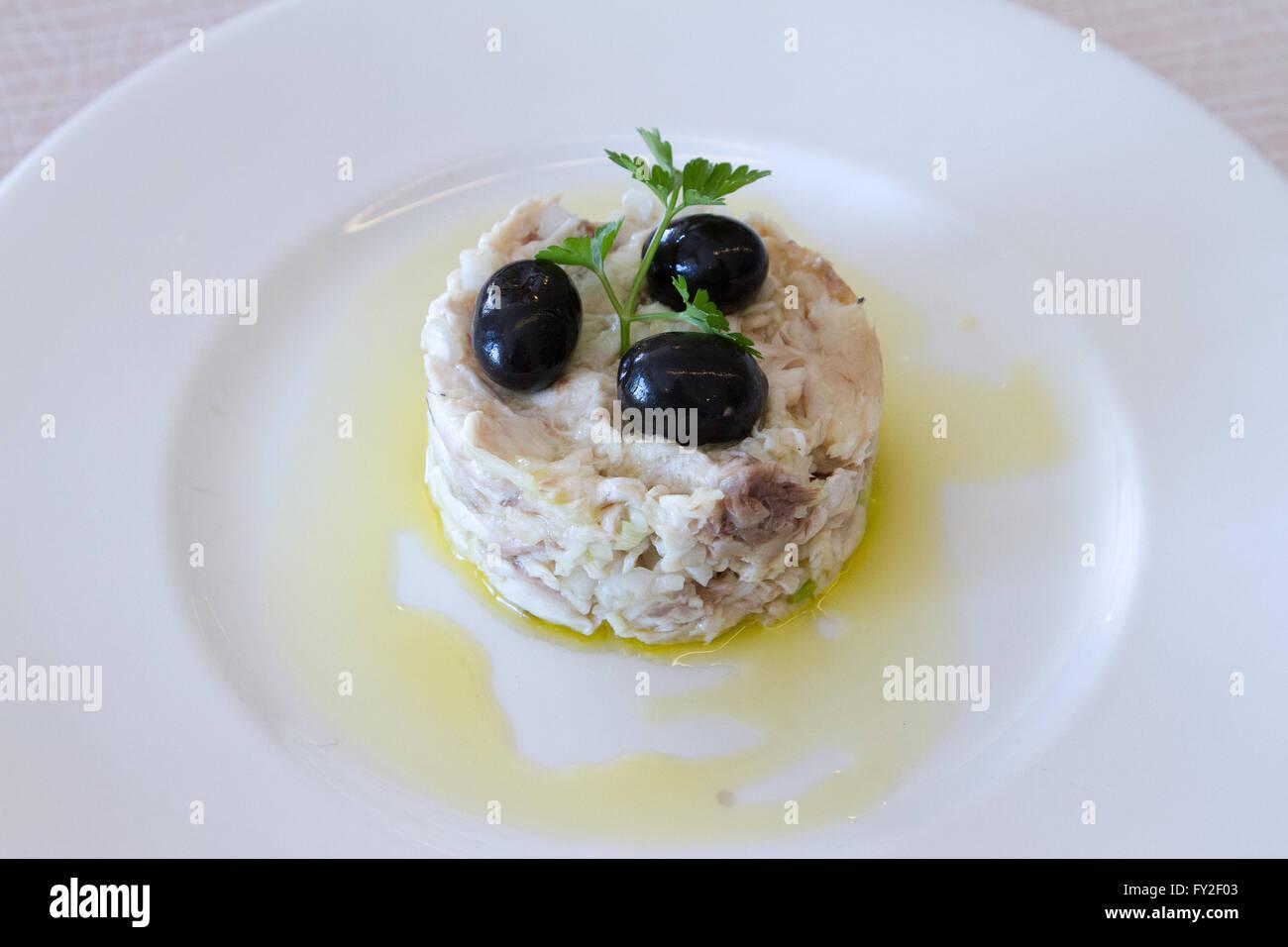 Fish and olive salad Stock Photo