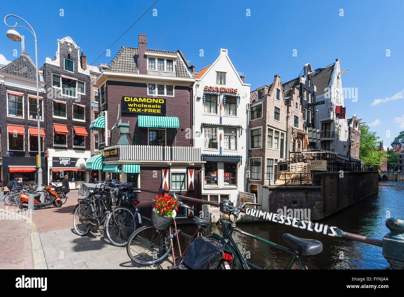 Amsterdam diamont factory , Grimnesssluis, bicycles, tulips,  Amsterdam, Netherlands Stock Photo