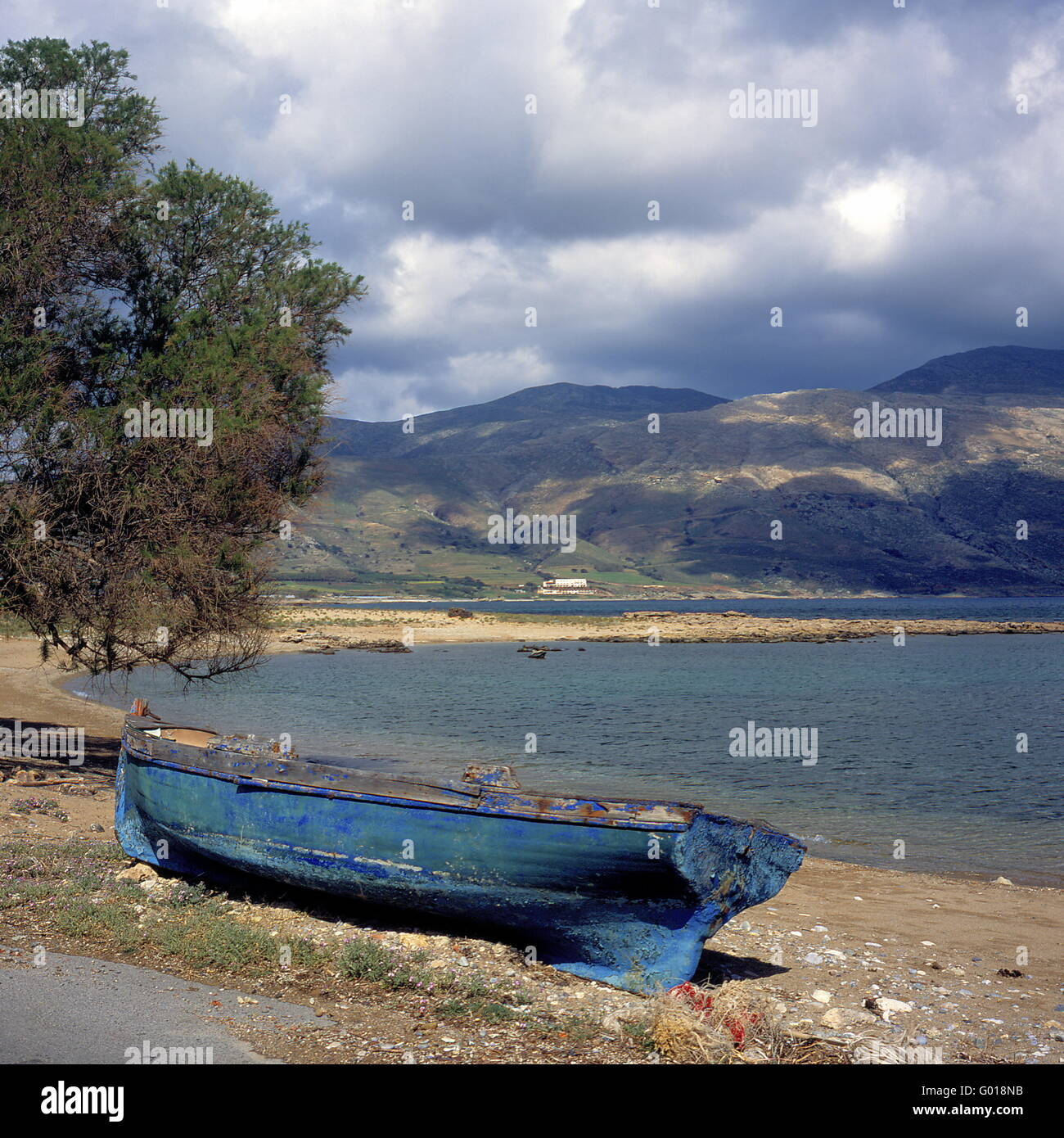 old fishing boat at the beach of Crete Island, Stock Photo