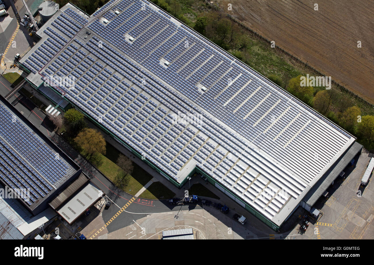 Aerial View Of Solar Panels On A Factory Roof North Of