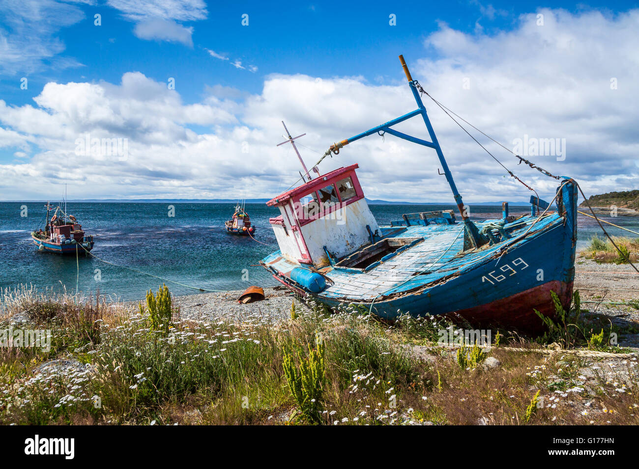 An old fishing boat on the shores of the strait of for Old fishing boat
