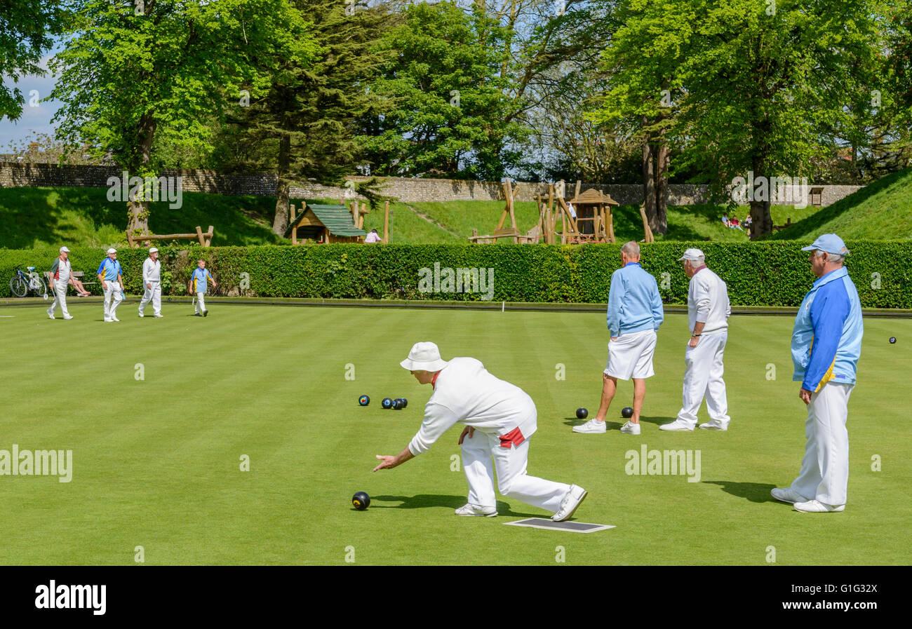 elderly-lady-bowling-on-a-bowling-green-