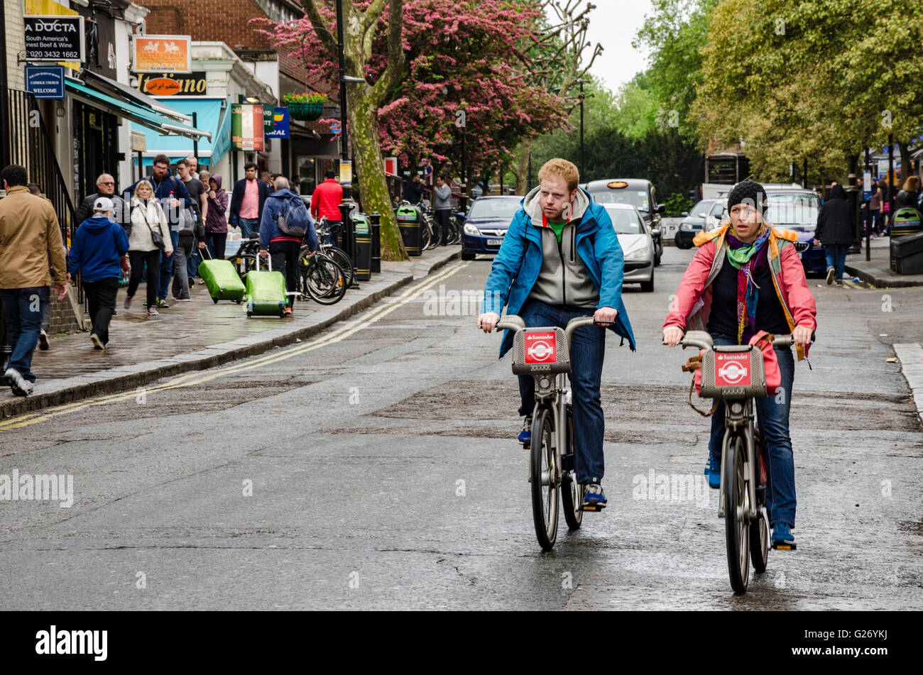 a-couple-of-cyclists-on-boris-bikes-ride