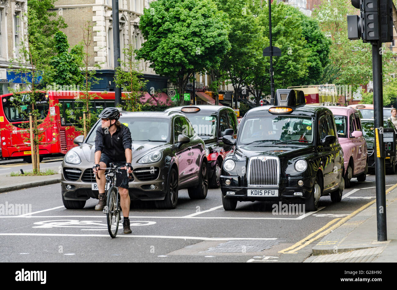 a-cyclist-waits-at-the-head-of-a-queue-a