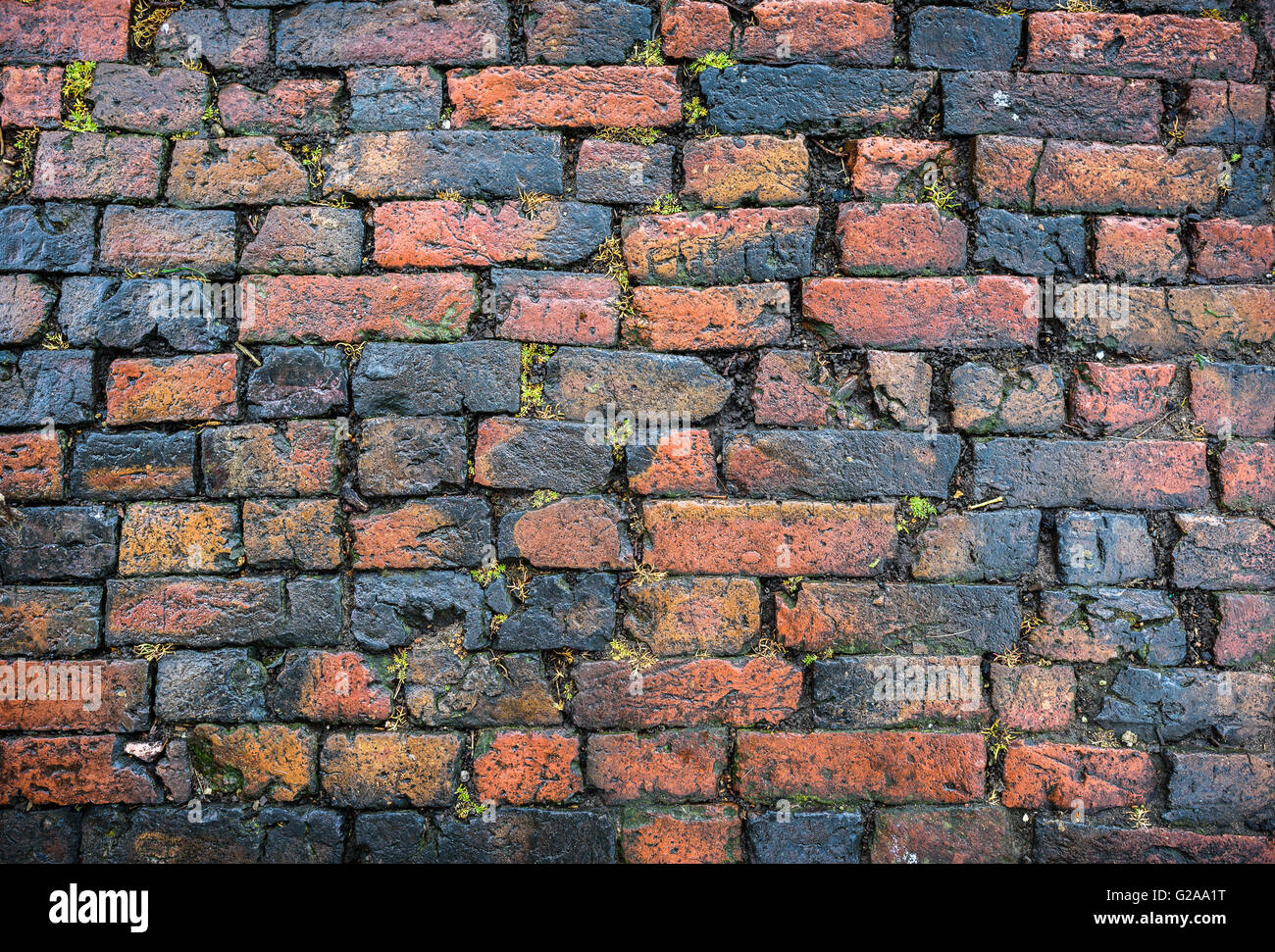 an-old-brick-cobbled-road-surface-G2AA1T