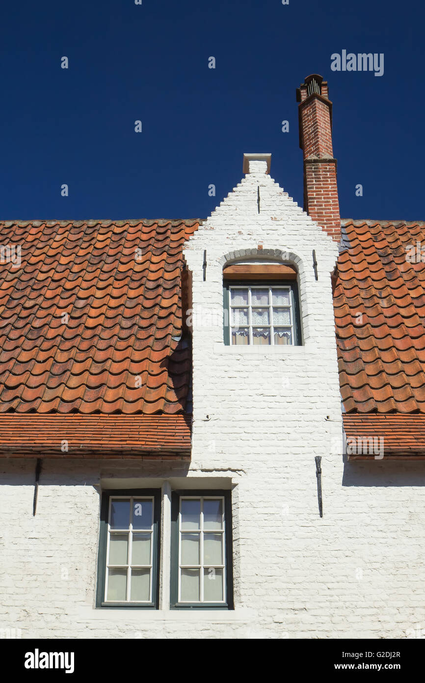 White brick house with three windows and red roof bruges belgium stock photo royalty free - Small belgian houses brick ...