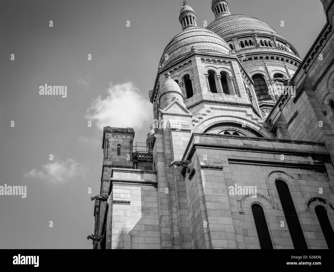 Sacre-Coeur Basilica in Paris is a major tourist attraction with its huge rounded domes and beautifully detailed Stock Photo