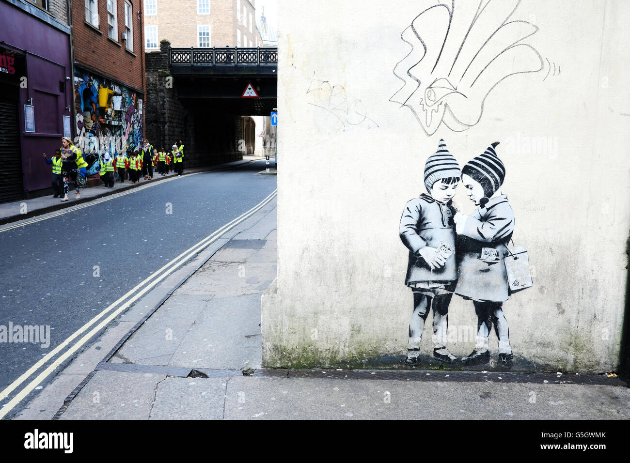 banksy-style-black-and-white-graffiti-of