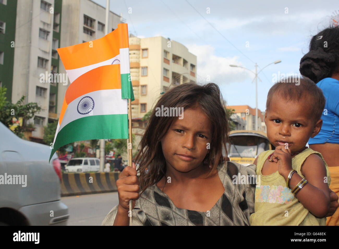 Poor Indian girl waving Indian flag on Indian Independence ...