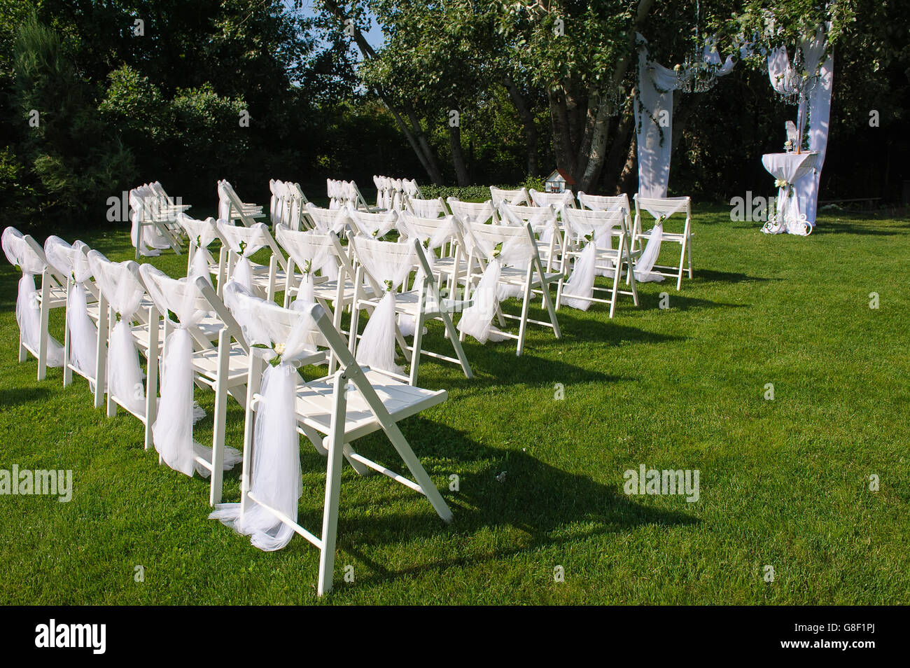 White Chairs At A Wedding Indoor Stock Photo: Arch For Wedding Ceremony. White Decorated Chairs On A