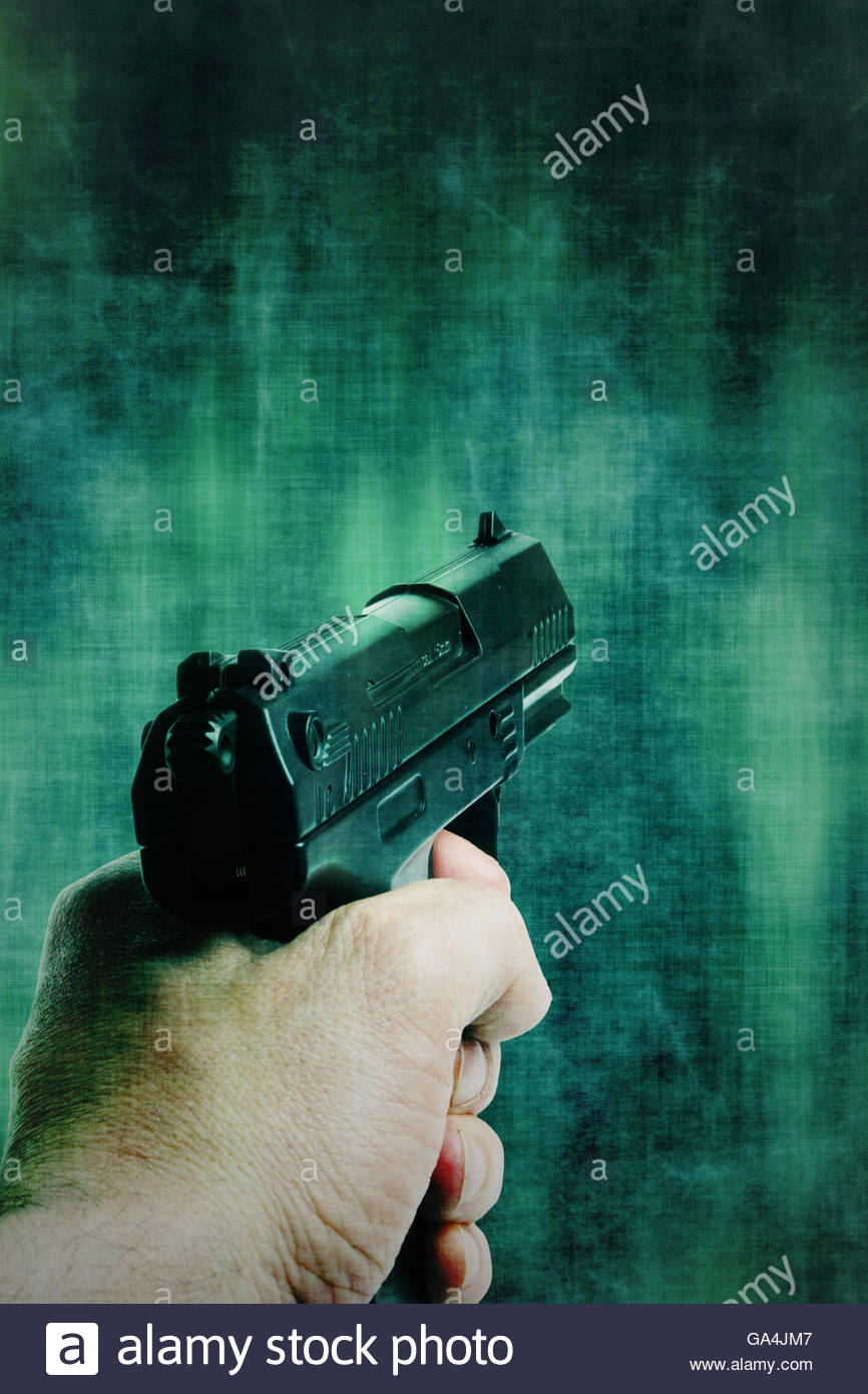 man hand holding a gun pointed Stock Foto