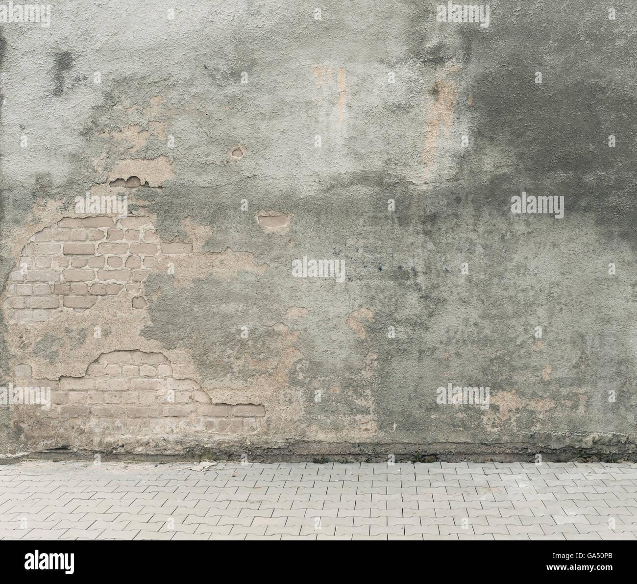 Urban background. Grunge obsolete street wall and pavement ...
