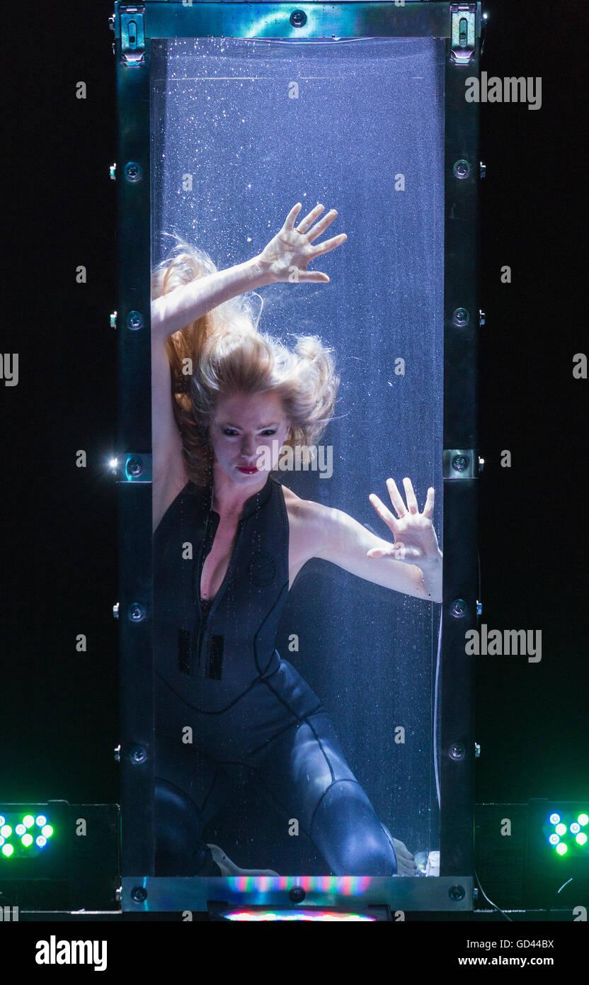 Water Tank Magic : London uk july josephine lee in a water tank