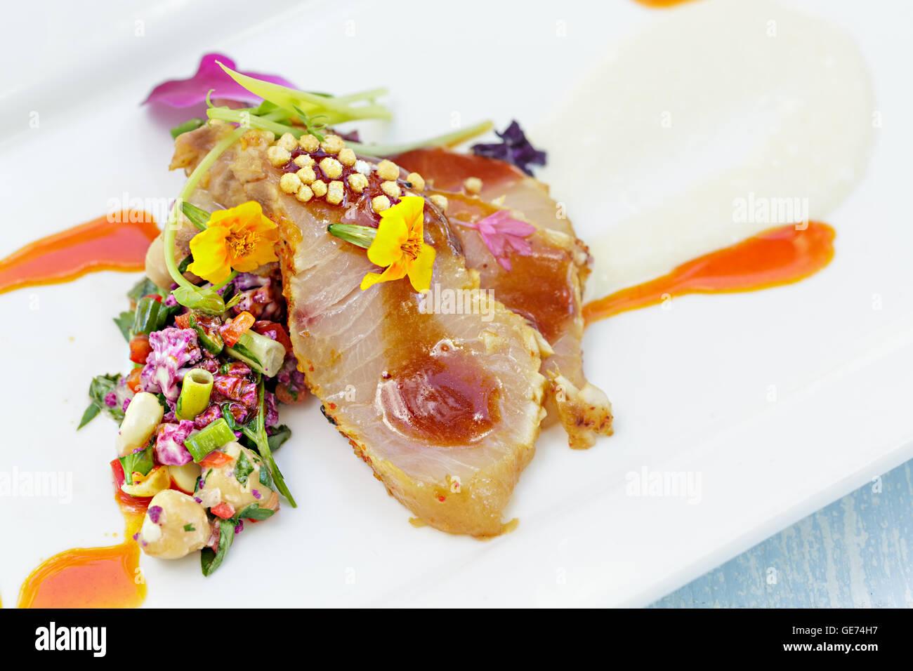 Charred hamachi seasoned with togarashi and garnished with for Edible hawaiian fish