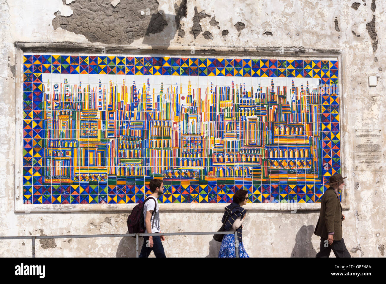 three-tourists-pass-by-an-abstract-mural