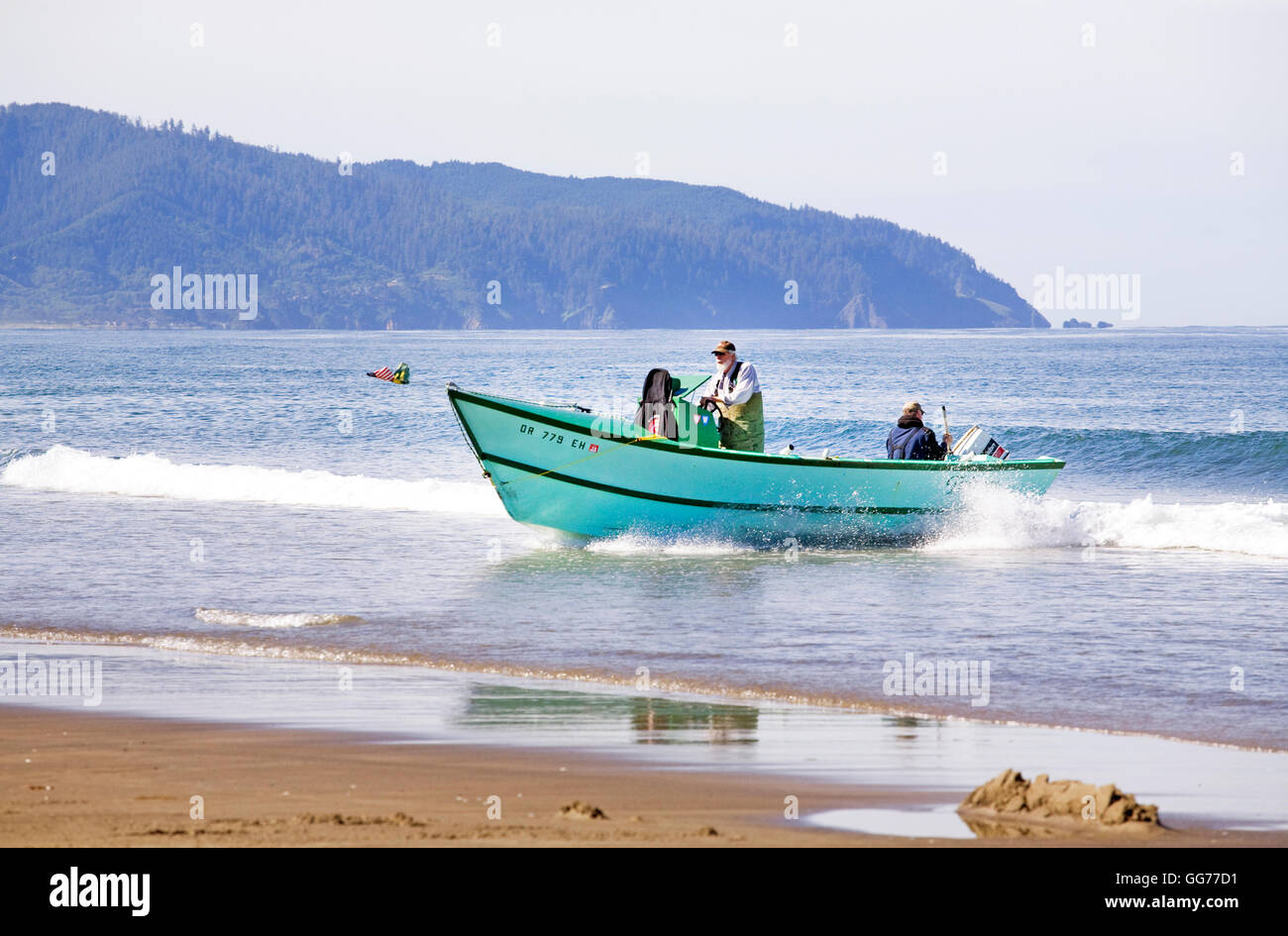 A dory boat lands on the beach at high speed in Pacific City, Oregon Stock Photo, Royalty Free ...