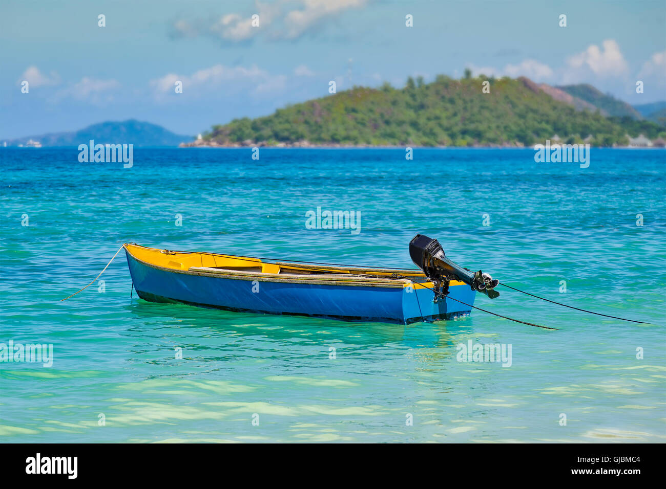 Colorful small blue fishing boat with outboard motor for Small fishing boats with motor
