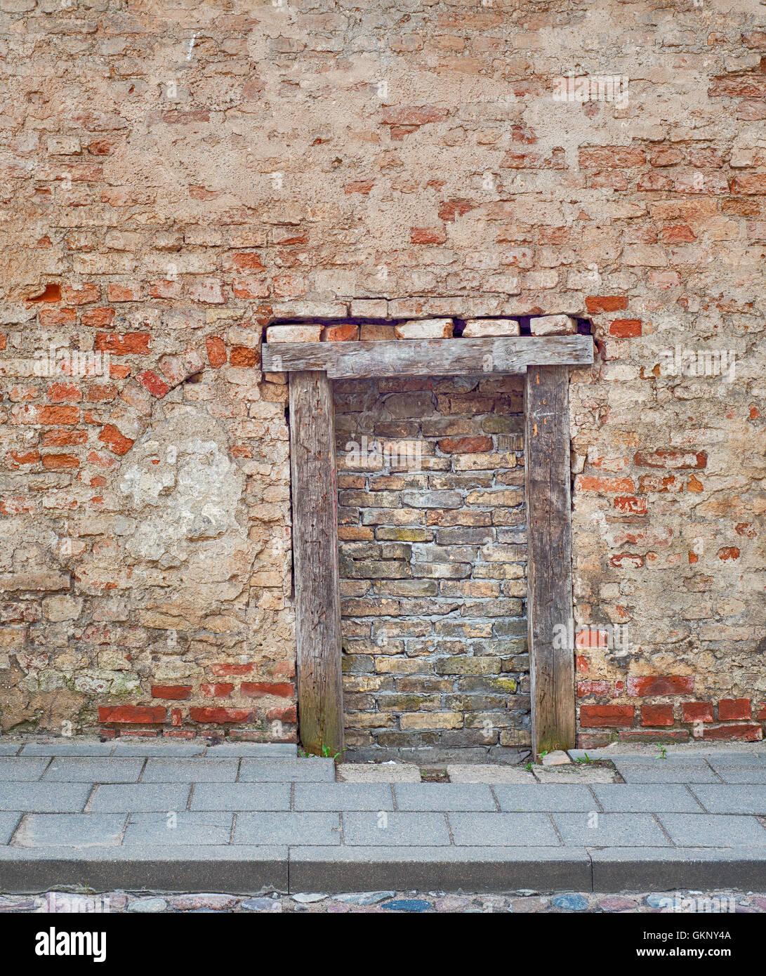 Cracked Brick Wall With Bricked Up Doorway Stock Photo Royalty Free Image 1