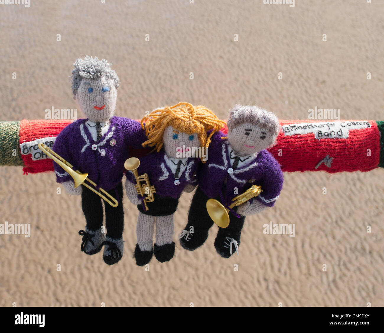 knitted-brass-band-players-with-text-gri