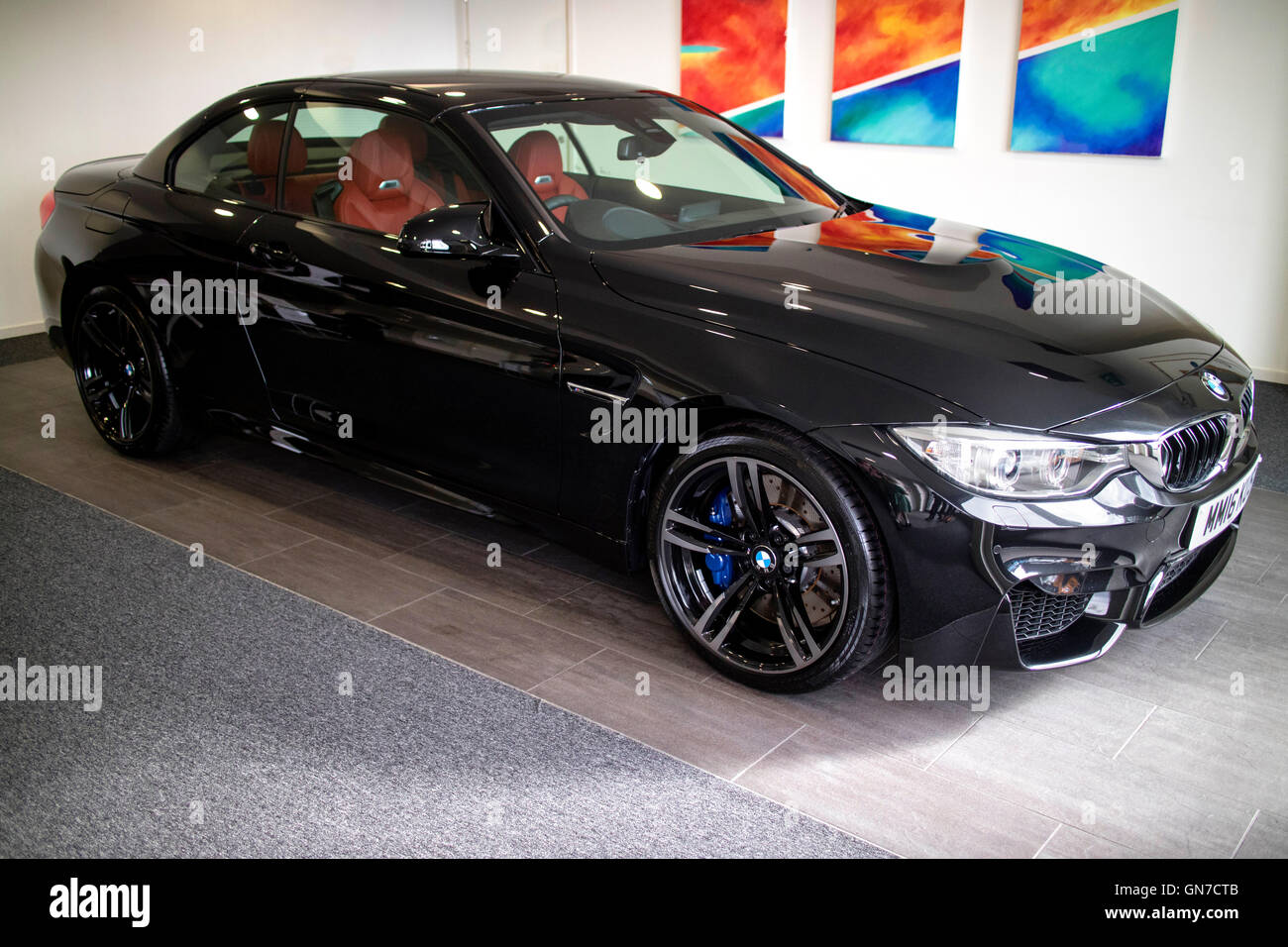 brand new 2016 f83 black bmw m4 convertible 2 door coupe with sakhir stock photo royalty free. Black Bedroom Furniture Sets. Home Design Ideas