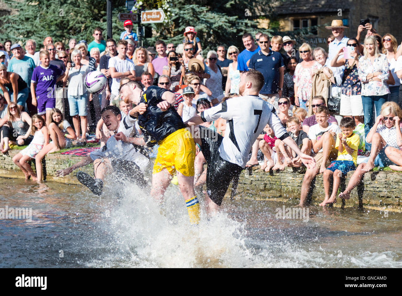 football-game-in-the-river-at-bourton-on