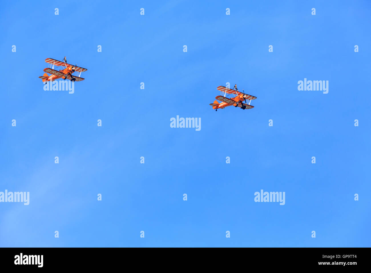 Eastbourne  International Airshow Airbourne  2 1940's Breiting Wingwalkers Boeing Stearman Biplanes fly over the Stock Photo
