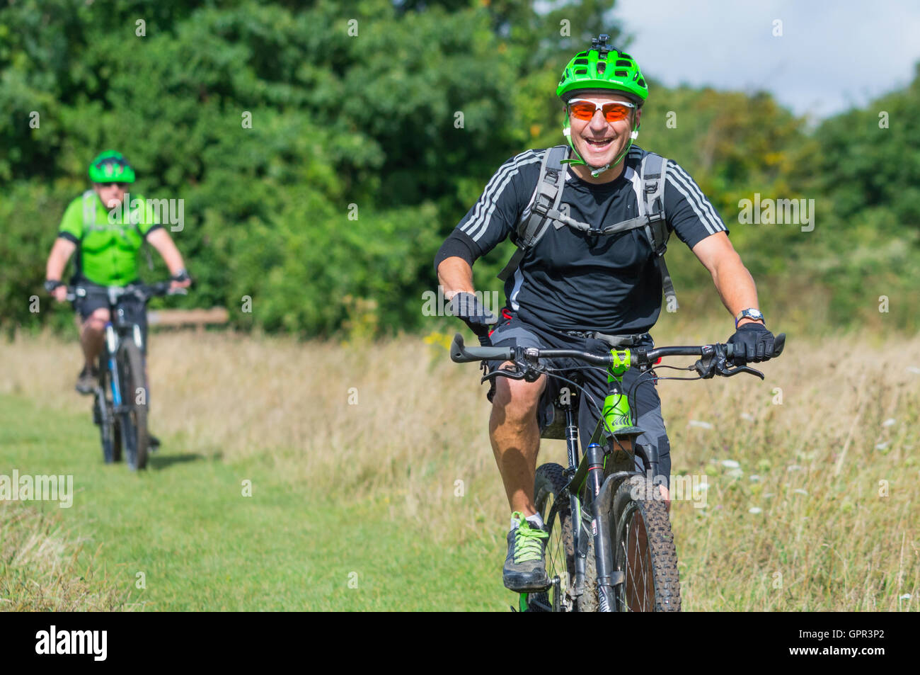 cyclists-wearing-helmets-in-the-countryside-enjoying-the-ride-on-the-GPR3P2.jpg