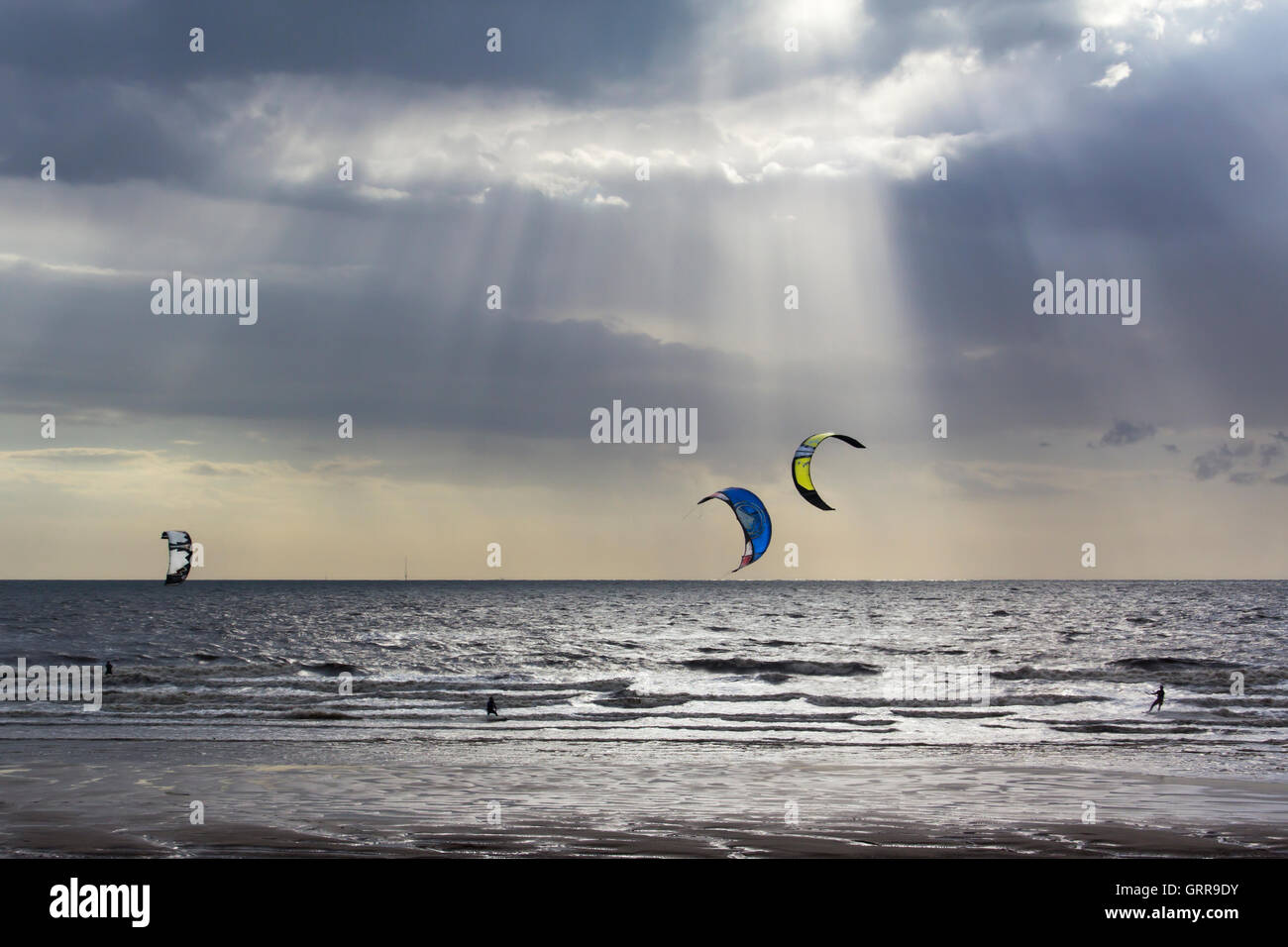 three-kiteboarders-engaging-in-their-ext