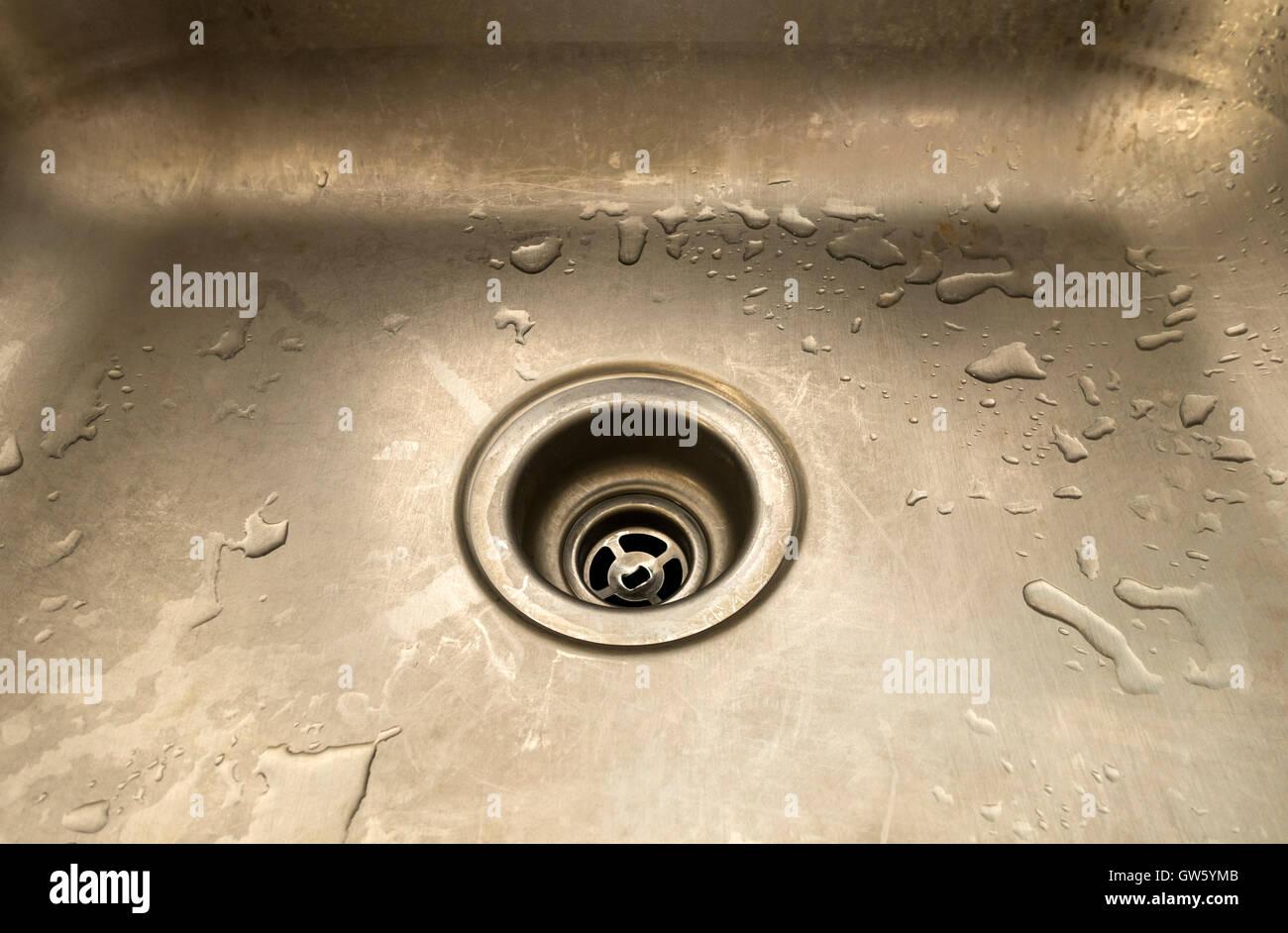 empty-wet-kitchen-sink-with-open-drain-G