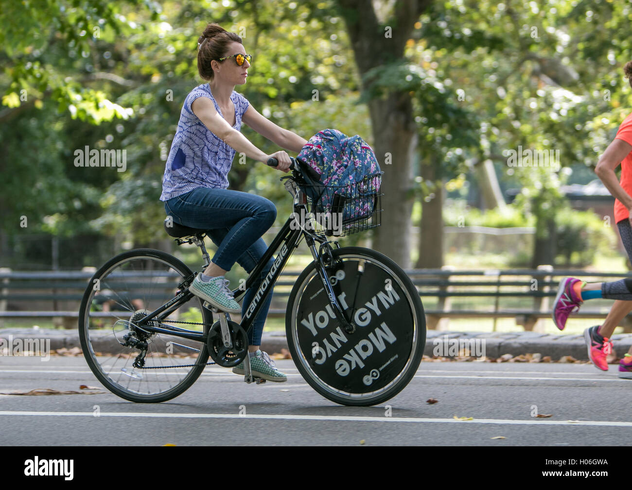 a-young-woman-is-riding-a-bicycle-in-cen